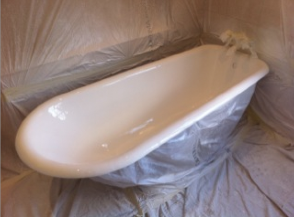 A bath that has been resurfaced. The picture shows the masking around the bath and the room still in place.