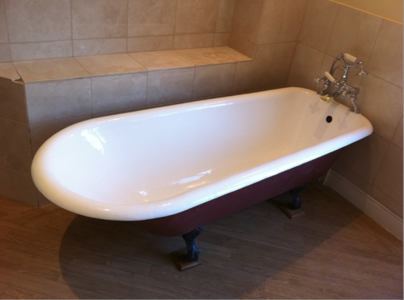 A lovely tapered roll top bath fully resurfaced and made to look new again. Very shiny white interior. All the masking sheets have been removed from the walls and bath.